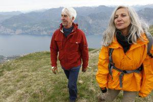 Senior couple hiking in mountain range, Italy